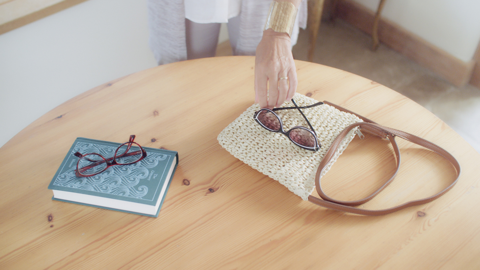 Production still of lady choosing sunglasses