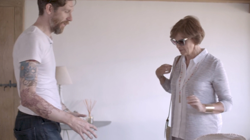 Frame from clip of Marcus, MD and Technical Lead and Sue, Talent from Small Victories Shoot discussing the action and direction for shot 13
