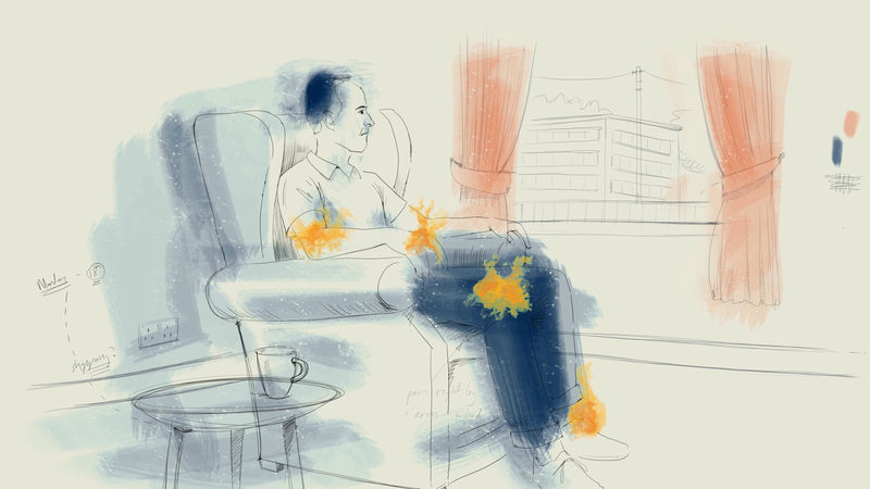 Frame from Steven's Diary, an animation from The Arthritis Patient Diaries series.  Steven is sat in a chair at home, looking out of the window. His legs have flames on his clothes, illustrating where his joints give him pain.