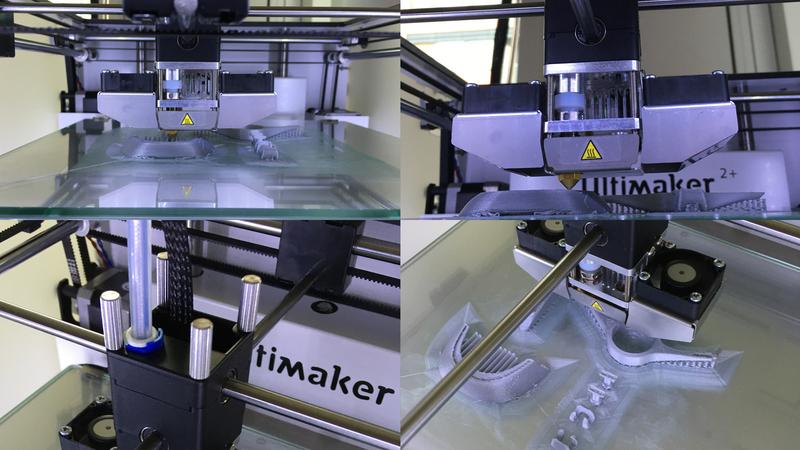 Photograph of a 3D printer, printing.