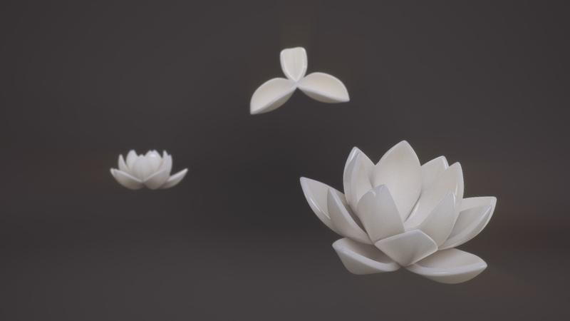 Three ceramic white flowers in bloom.